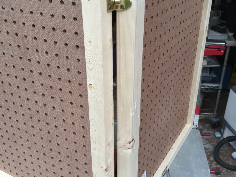 Make a folding pegboard display